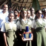 Photo of some of the members of the Young Leaders group with their prize at the national science fair with a representative from Lucelec