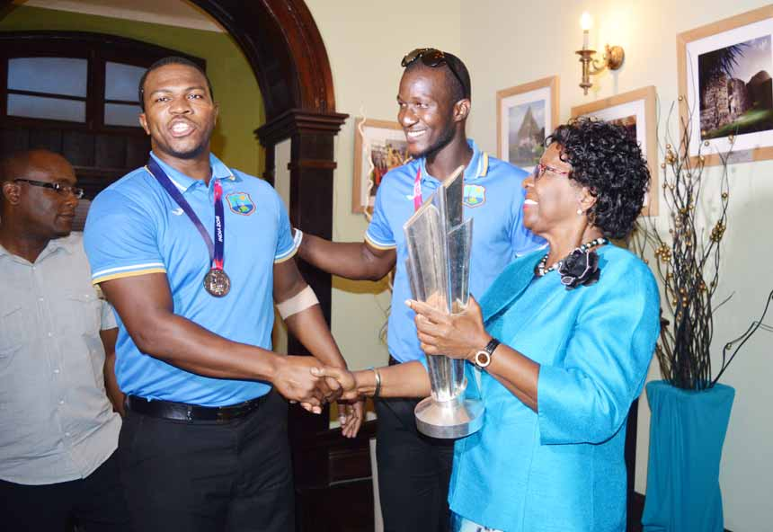 Image: Darren Sammy and Johnson Charles with Governor General Dame Pearlette Louisy