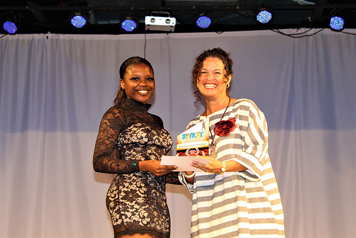 Image: Best Actress Khadelia Williams (left) receives her award from adjudicator Katherine Atkinson.