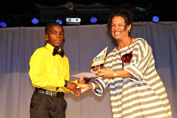 Image: Best Actor Odida Parkinson (left) receives his award from adjudicator Katherine Atkinson.